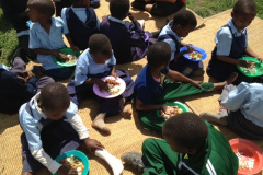 UGANDA-SCHOOL-CHILDREN-EATING