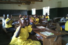 UGANDA-STUDENTS-WAVE-YELLOW-IN-CLASSROOM